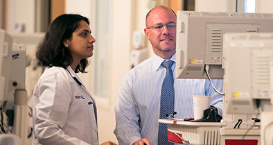 Nemours critical care physician instructs fellow.