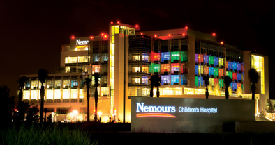 Picture of the Nemours Children's Hospital building at night