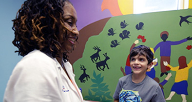 Dr. Odett Renee Stanley-Brown, a pediatrician in our Clermont office, speaks with a young patient.