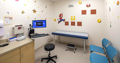 This exam room's walls are decorated in the Mario Brothers theme.