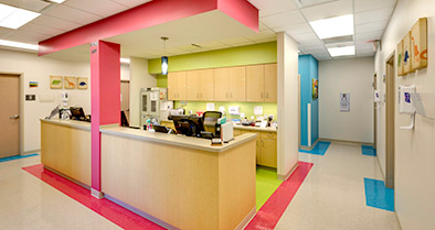 The walls and floors of our pediatric primary care office are bright and colorful.