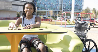 A pediatric patient enjoys one of the outdoor spaces at our children's hospital.