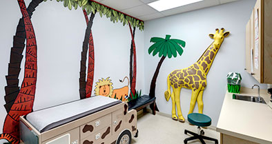 An exam room decorated in a jungle theme.