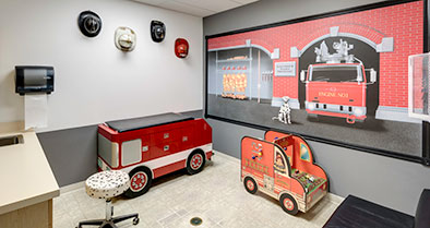 An exam room decorated in a fire station theme.