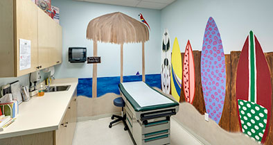An exam room decorated in a beach theme.