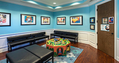 A spacious waiting room, which includes a kids' activity table.