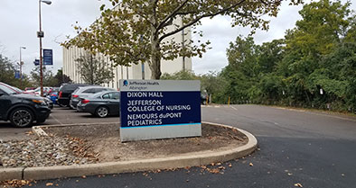 Nemours duPont Pediatrics sign at the entrance of the parking lot.