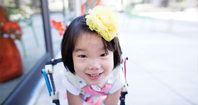 Young girl with plastic exoskeleton we developed to help her with arthrogryposis.