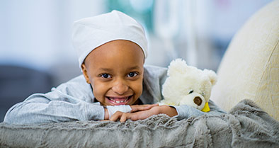 Young girl, smiling, being treated for bone marrow failure at Nemours.