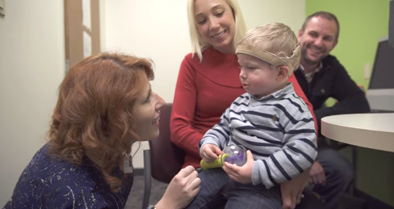 Tiernan, a young boy with new cochlear implant about to hear for first time.