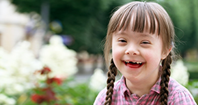 Happy girl being cared for by Nemours Down syndrome experts.