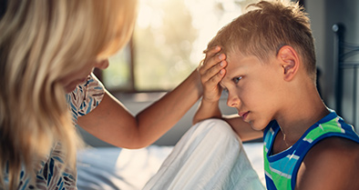 Young boy being seen by Nemours experts for headaches and migraines.