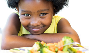 Young girl happy and healthy with the help of Nemours nutrition expertise.