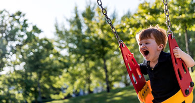 Young boy with PA/IVS on a swing.