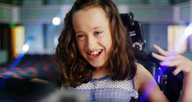 Girl with cerebral palsy smiles during a visit to Nemours for care.