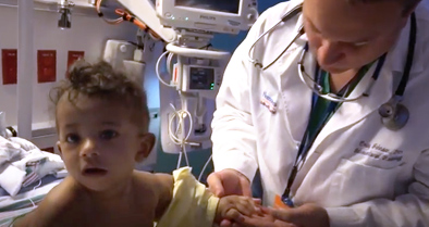 Nemours interventional radiology physician examines child for treatment.