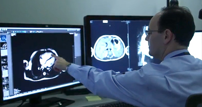 Pediatric radiology physician examines imaging test results.