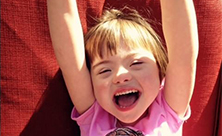 Girl diagnosed with Down syndrome during perinatal testing smiles